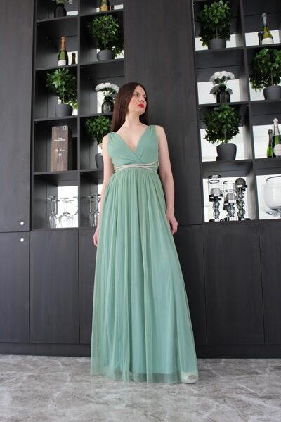 Žalsva blizganti suknelė